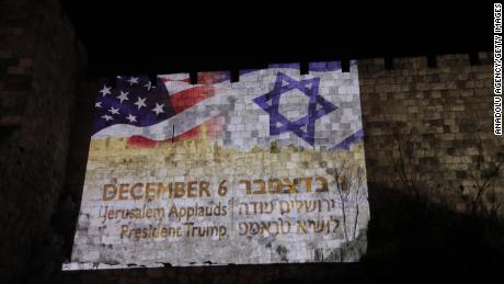 Flags of the United States and Israel are reflected on wallss around the Old City of Jerusalem.