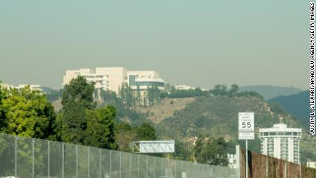 Smoke begins to cloud around the Getty Center as the Skirball Fire burns Wednesday.