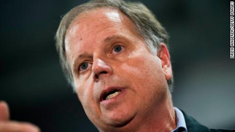 Democratic candidate for U.S. Senate Doug Jones takes questions from reporters at a fish fry campaign event at Ensley Park, November 18, 2017 in Birmingham, Alabama. Jones has moved ahead in the polls of his Republican opponent Roy Moore, whose campaign has been rocked by multiple allegations of sexual misconduct. (Photo by Drew Angerer/Getty Images)