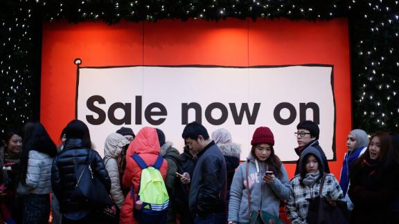 People in London wait in line in anticipation of the Boxing Day sales at Selfridges.