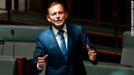 Former Australian Prime Minister Tony Abbott -- considered the face of the campaign to reject same-sex marriage -- discusses amendments to the marriage equality bill at Parliament House on Thursday.