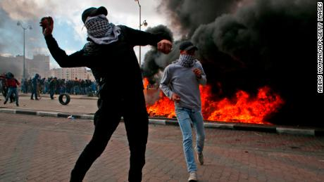 Palestinian demonstrators clash with Israeli security officers during protests in Ramallah on Thursday.