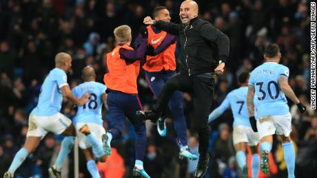 Manchester City's Spanish manager Pep Guardiola celebrates after Manchester City's English midfielder Raheem Sterling scores his team's second goal during the English Premier League football match between Manchester City and Southampton at the Etihad Stadium in Manchester, north west England, on November 29, 2017. Manchester City won the match 2-1. / AFP PHOTO / Lindsey PARNABY / RESTRICTED TO EDITORIAL USE. No use with unauthorized audio, video, data, fixture lists, club/league logos or 'live' services. Online in-match use limited to 75 images, no video emulation. No use in betting, games or single club/league/player publications.  /         (Photo credit should read LINDSEY PARNABY/AFP/Getty Images)