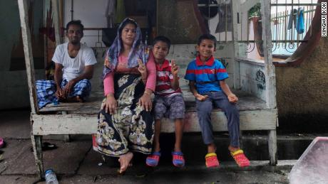 Abdul Syukui, 40, sitting with his wife Hamidah Gonumia, 30, and younger sons Sabarek Khan Abdul, 8, and Nojumullah Abdul.
