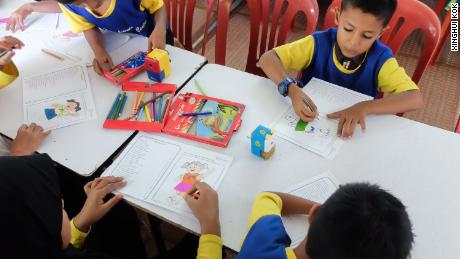 Younger students doing colouring work.jpg