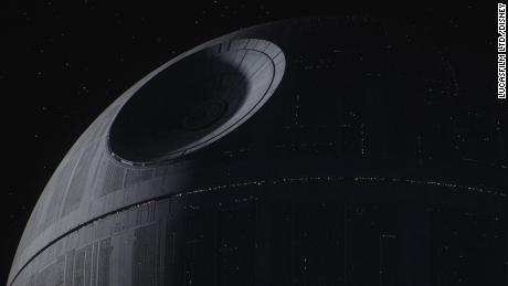 "The Death Star in ""Rogue One: A Star Wars Story."" Not originally conceived as spherical, it took its shape after production designer John Barry added a curve to the lengthy corridors requested by Lucas."