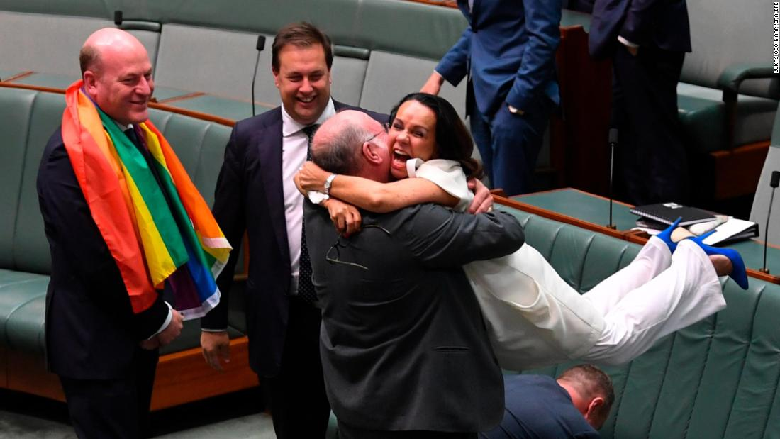 "Warren Entsch lifts up fellow Parliament member Linda Burney on Thursday, December 7, as they celebrate the passing of a bill that <a href=""http://www.cnn.com/2017/12/07/asia/australia-same-sex-marriage-intl/index.html"" target=""_blank"">legalizes same-sex marriage in Australia.</a>"