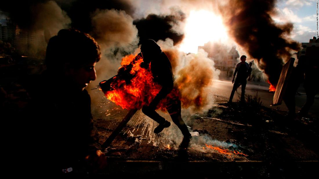 "A Palestinian protester runs Thursday, December 7, after catching fire during clashes with Israeli troops near Beit El, a Jewish settlement in the West Bank. Dozens of people were injured in <a href=""http://www.cnn.com/2017/12/07/middleeast/trump-jerusalem-response-intl/index.html"" target=""_blank"">West Bank protests,</a> which began after US President Donald Trump announced that his country would be recognizing Jerusalem as the capital of Israel. Both Israelis and Palestinians claim the holy city as their capital."