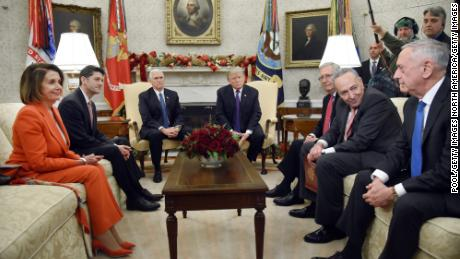 WASHINGTON, DC - DECEMBER 07: (AFP OUT) U.S. President Donald Trump and Vice President Mike Pence meet with Congressional leadership including House Minority Leader Rep. Nancy Pelosi (D-CA), House Speaker Paul Ryan (R-WI), Senate Majority Leader Mitch McConnell, Sen. Chuck Schumer (D-NY) and U.S. Defense Secretary James Mattis in the Oval Office of the White House on December 7, 2017 in Washington, DC.  (Photo by Olivier Douliery - Pool/Getty Images)