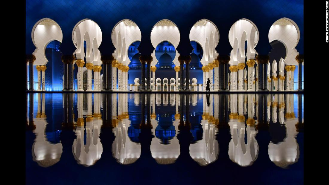 Visitors walk in the courtyard of the Sheikh Zayed Grand Mosque in Abu Dhabi, United Arab Emirates, on Sunday, December 3.