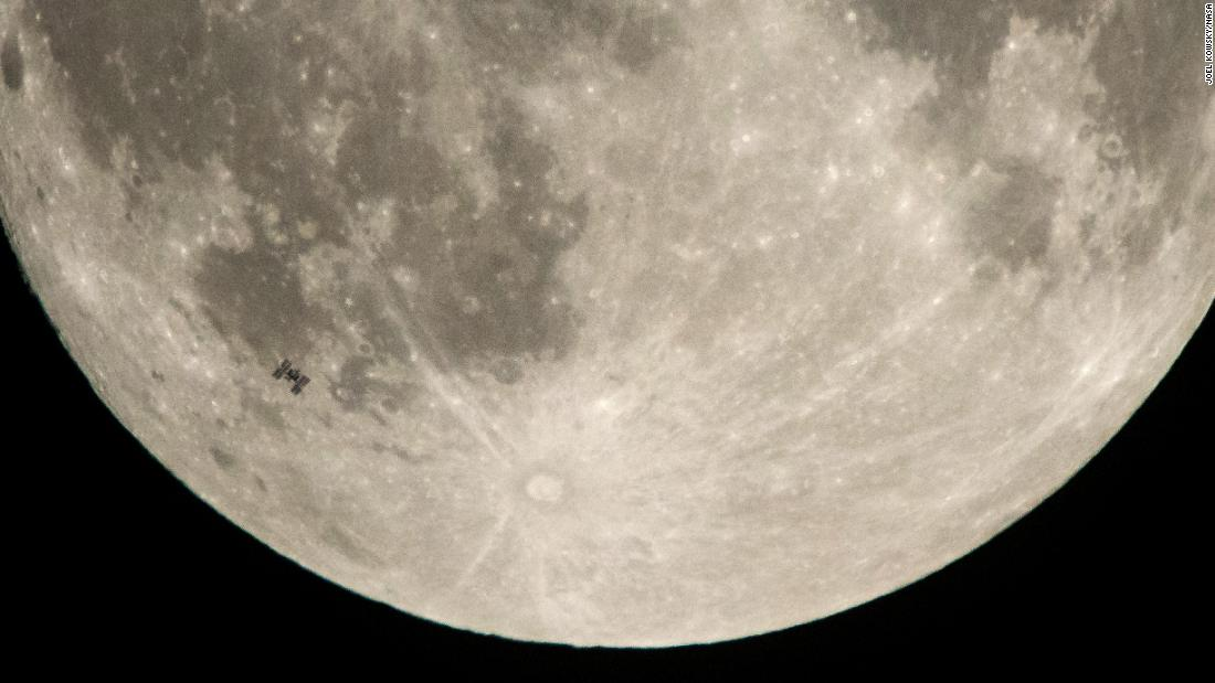 The International Space Station, lower left, is seen against the moon in this photo taken in Manchester Township, Pennsylvania, on Saturday, December 2.