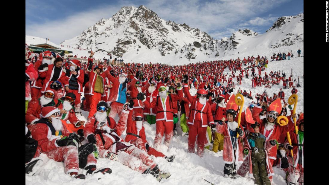 More than 2,000 people in Santa Claus costumes pose for a picture at the Swiss ski resort of Verbier on Saturday, December 2. On what was the opening day of ski season, the resort offered a free daily pass to every skier dressed as Santa.