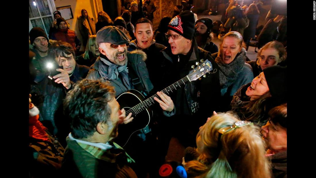"Fans sing songs of Johnny Hallyday outside his house in Marnes-la-Coquette, France, on Wednesday, December 6. Hallyday, <a href=""http://www.cnn.com/2017/12/05/entertainment/johnny-hallyday-obit/index.html"" target=""_blank"">a rock 'n' roll icon in France,</a> had just died at the age of 74."