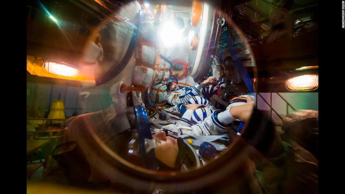 Three astronauts take part in preflight preparations at the Baikonur Cosmodrome in Kazakhstan on Tuesday, December 5. They will be heading to the International Space Station later this month.