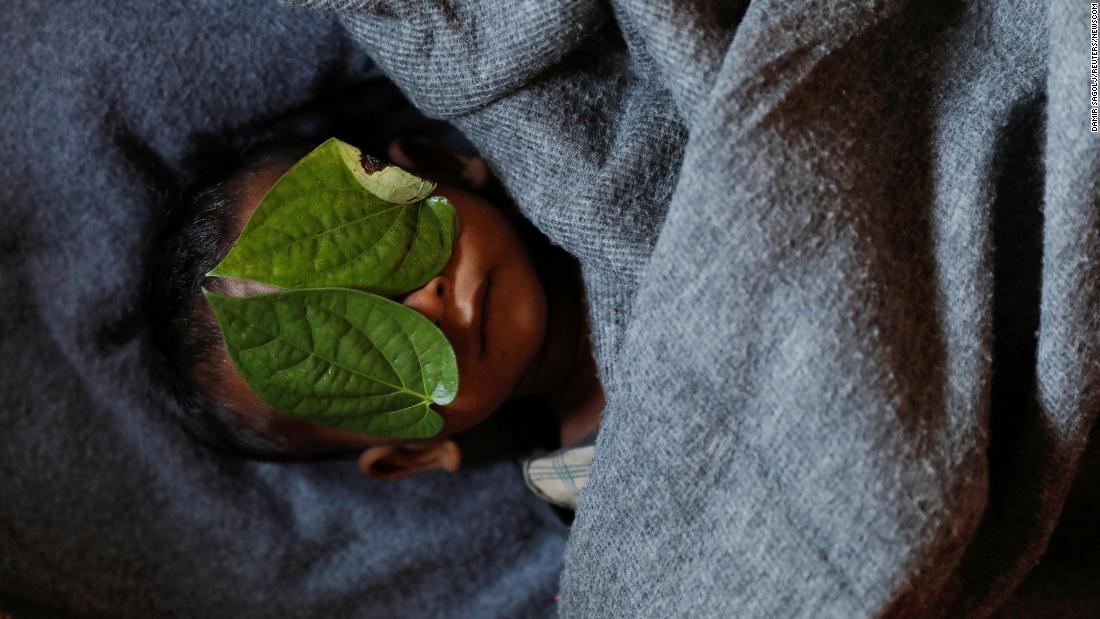 Leaves cover the face of Rohingya refugee Abdul Aziz, an 11-month-old who died at a clinic in Bangladesh on Monday, December 4. The boy, whose family fled Myanmar a couple of months ago, had suffered from a high fever and severe cough, according to his mother. His body was brought back to the family's shelter at the Balukhali refugee camp near Cox's Bazar, Bangladesh.