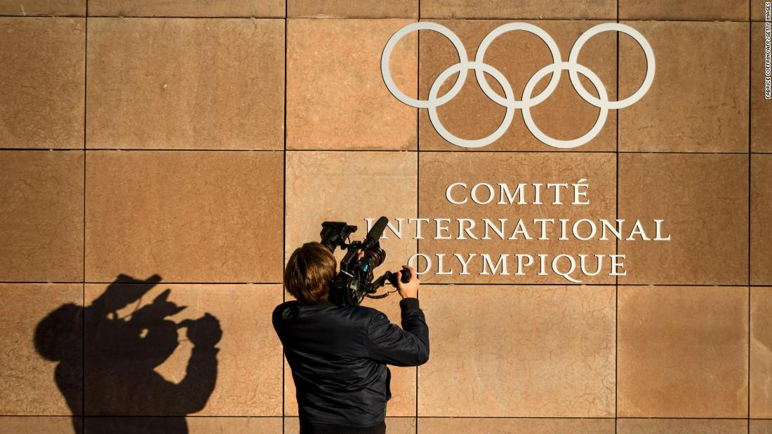 "A television cameraman films the logo of the International Olympic Committee at its headquarters in Pully, Switzerland, on Tuesday, December 5. <a href=""http://www.cnn.com/2017/12/05/sport/russia-ioc-ruling-intl/index.html"" target=""_blank"">Russia has been banned from the 2018 Winter Olympics</a> over the country's ""systemic manipulation"" of anti-doping rules, but Russian athletes who can prove that they are clean will be invited to compete under the Olympic flag, the IOC said."