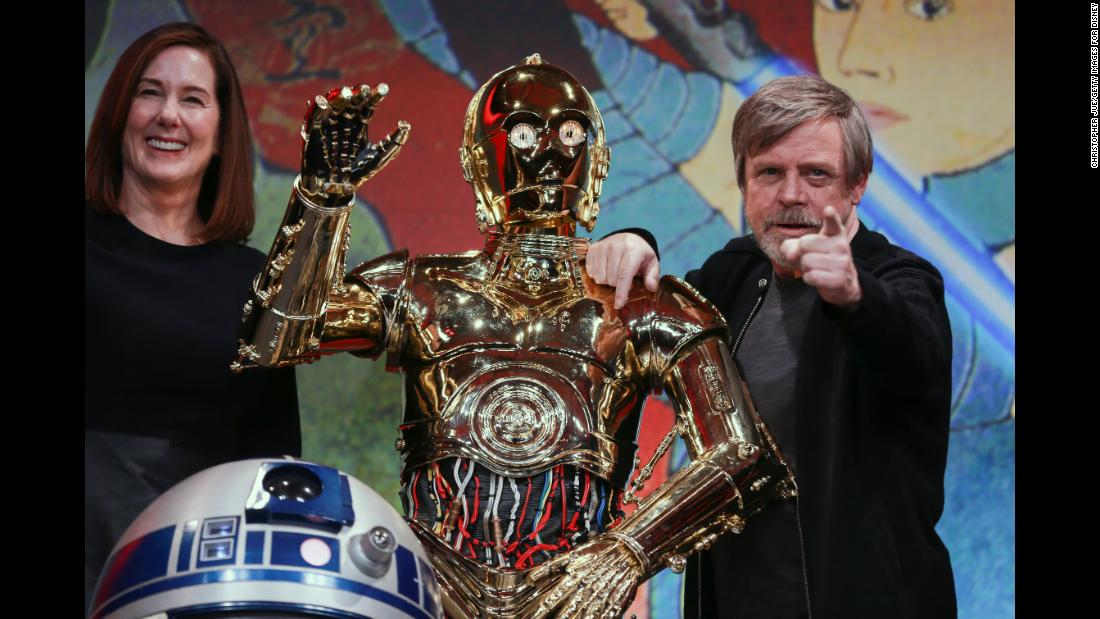 "Actor Mark Hamill joins C-3PO, R2-D2 and producer Kathleen Kennedy for a ""Star Wars"" press conference in Tokyo on Thursday, December 7. Hamill stars as Luke Skywalker in the new movie ""Star Wars: The Last Jedi."""