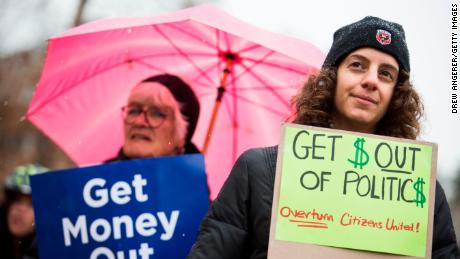 WASHINGTON, DC - JANUARY 21: From L, Danielle Greene and Jennifer Vassil attend a rally calling for an end to corporate money in politics and to mark the fifth anniversary of the Supreme Court's Citizens United decision, at Lafayette Square near the White House, January 21, 2015 in Washington, DC. Wednesday is the fifth anniversary of the landmark ruling, which paved the way for additional campaign money from corporations, unions and other interests and prevented the government from setting limits on corporate political spending. (Photo by Drew Angerer/Getty Images)
