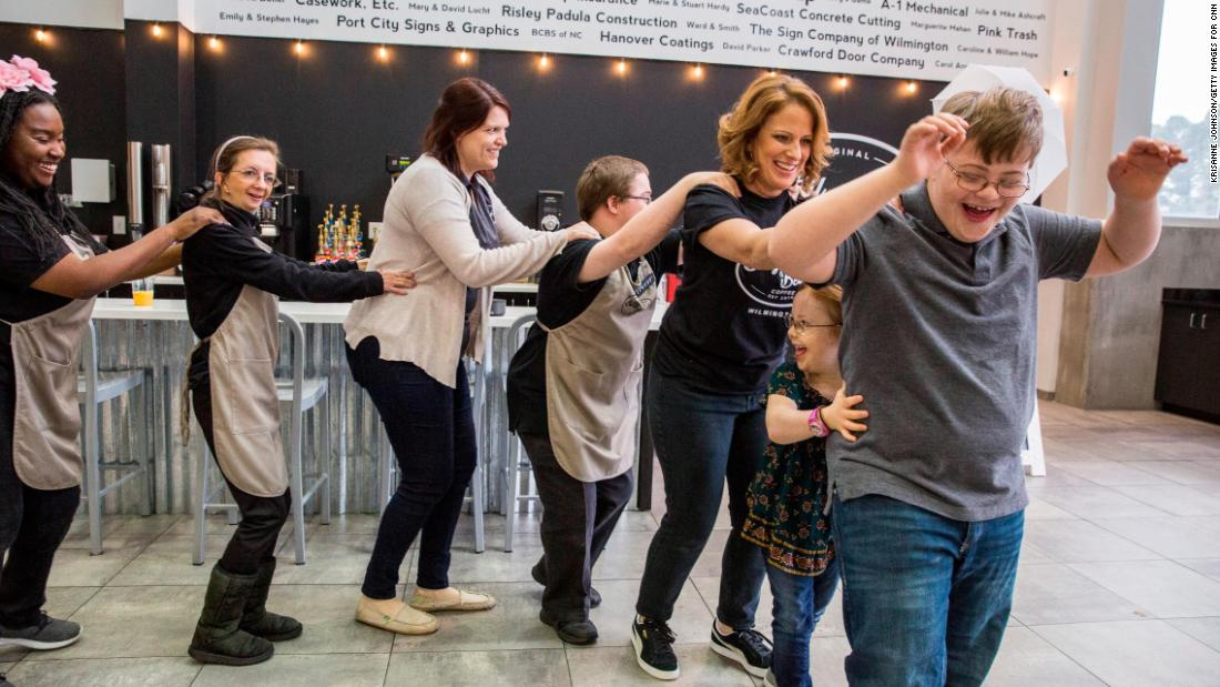 Sometimes, the shop's staff takes a 'dance break'.  Here, their conga line is joined by Wright's two youngest children, Bitty, 7, and Beau, 12, who both have Down syndrome.   When Wright and her husband discovered that 70% of those with intellectual disabilities don't have jobs, they opened the coffee shop to do something about it.