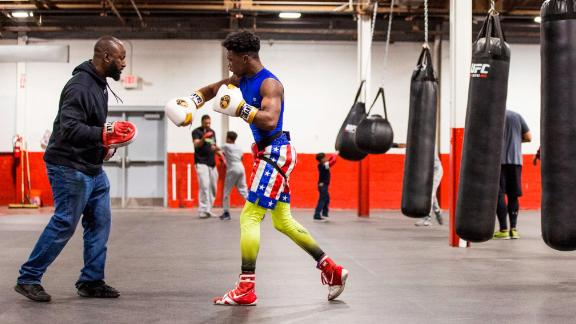 """Sweeney has long had a passion for boxing, and he realized it could help young people develop discipline in other areas of life. What started as free lessons and mentoring, all paid out of his own pocket, is today a 27,000 square foot gym. It may look like a typical boxing gym at first glance, but the tutoring tables, computers and books give it away. Sweeney's motto is """"Books before boxing."""""""