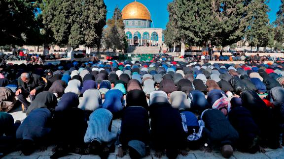 Palestinian Muslim worshippers pray in front of the Dome of the Rock mosque at the al-Aqsa mosque compound in the Jerusalem