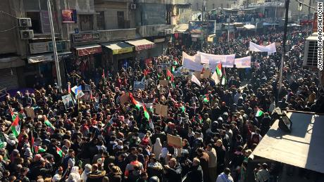 Protesters march through Amman, Jordan's capital, on Friday.