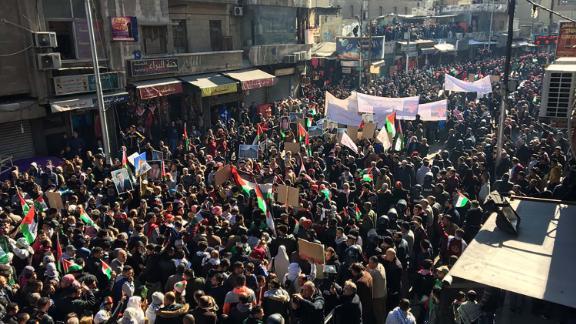 Protesters march through Amman, Jordan's capital, on Friday.