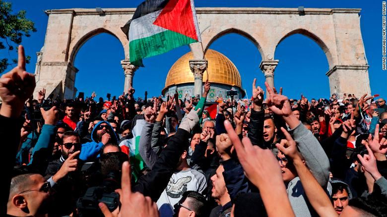 Palestinian Muslim worshippers shout slogans during Friday prayers near the al-Aqsa mosque compound in Jerusalem's Old City.