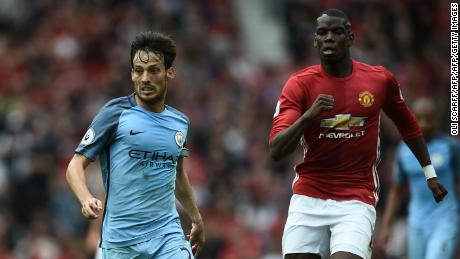 Manchester City's Spanish midfielder David Silva (L) vies with Manchester United's French midfielder Paul Pogba during the English Premier League football match between Manchester United and Manchester City at Old Trafford in Manchester, north west England, on September 10, 2016. Pep Guardiola savoured a derby success over arch-rival Jose Mourinho on Saturday as Manchester City beat Manchester United 2-1 in an engrossing Premier League clash.  / AFP / Oli SCARFF / RESTRICTED TO EDITORIAL USE. No use with unauthorized audio, video, data, fixture lists, club/league logos or 'live' services. Online in-match use limited to 75 images, no video emulation. No use in betting, games or single club/league/player publications.  /         (Photo credit should read OLI SCARFF/AFP/Getty Images)
