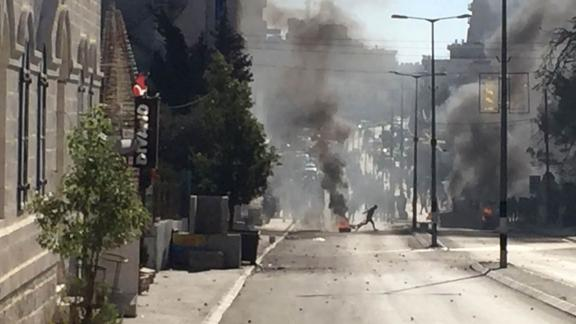 Palestinian protesters and Israeli security forces clash in Bethlehem on Friday.