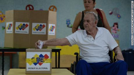 A Venezuelan votes during regional elections in Caracas' municipality of Chacao, where people choose the governor for the state of Miranda, on October 15, 2017. Venezuelans headed to the polls Sunday in regional elections seen as a crucial test for President Nicolas Maduro and the opposition alike after months of deadly street protests failed to unseat him. An estimated 18 million people are eligible to elect governors to four-year terms in 23 states. / AFP PHOTO / Federico PARRA        (Photo credit should read FEDERICO PARRA/AFP/Getty Images)