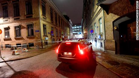 Police arrive after a synagogue was attacked in a failed arson attempt in Gothenburg, Sweden, late December 9, 2017.