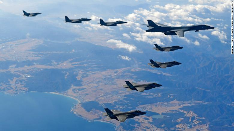 A US Air Force B-1 bomber and South Korean and US fighter jets fly over the Korean Peninsula during the Vigilant air combat exercise (ACE) on December 6, 2017.