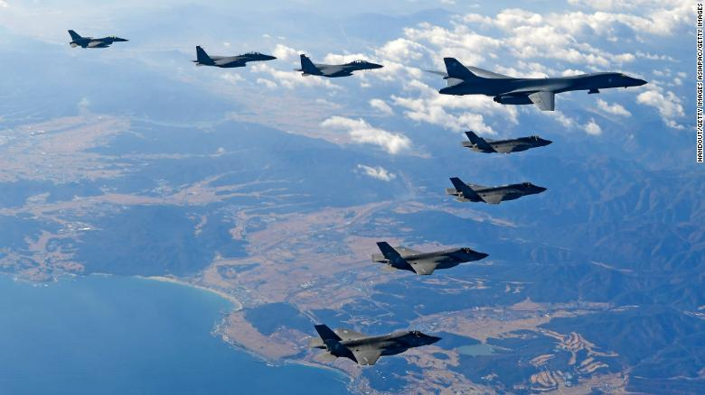 KOREAN PENINSULA, SOUTH KOREA - DECEMBER 06:  In this handout image provided by South Korean Defense Ministry, U.S. Air Force B-1B bomber (L), South Korea and U.S. fighter jets fly over the Korean Peninsula during the Vigilant air combat exercise (ACE) on December 6, 2017 in Korean Peninsula, South Korea. The largest-scale warplanes and military personnel take part in the annual joint exercise, which was scheduled before the North's latest missile test. North Korea fired a new intercontinental ballistic missile (ICBM) on November 29, believed to have shown capability to reach to the U.S. mainland.