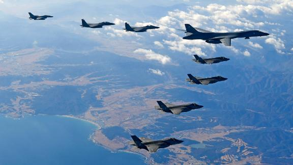KOREAN PENINSULA, SOUTH KOREA - DECEMBER 06:  In this handout image provided by South Korean Defense Ministry, U.S. Air Force B-1B bomber (L), South Korea and U.S. fighter jets fly over the Korean Peninsula during the Vigilant air combat exercise (ACE) on December 6, 2017 in Korean Peninsula, South Korea. The largest-scale warplanes and military personnel take part in the annual joint exercise, which was scheduled before the North