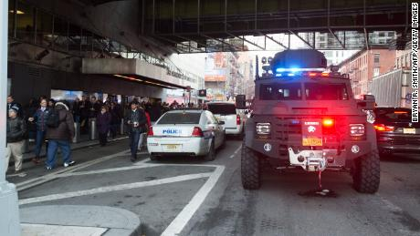 "Police and other first responders respond to a reported explosion at the Port Authority Bus Terminal on December 11, 2017 in New York. New York police said Monday that they were investigating an explosion of ""unknown origin"" in busy downtown Manhattan, and that people were being evacuated. Media reports said at least one person had been detained after the blast near the Port Authority transit terminal, close to Times Square.Early media reports said the blast came from a pipe bomb, and that several people were injured.  / AFP PHOTO / Bryan R. Smith        (Photo credit should read BRYAN R. SMITH/AFP/Getty Images)"