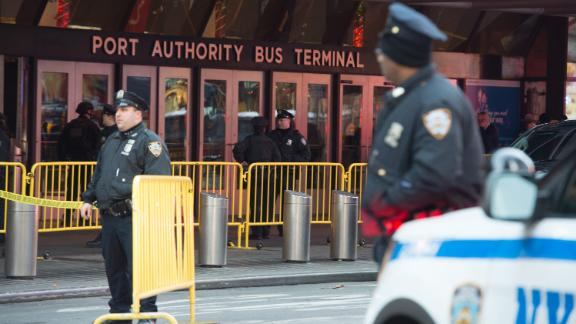 "Police respond to a reported explosion at the Port Authority Bus Terminal on December 11, 2017 in New York.  New York police said Monday that they were investigating an explosion of ""unknown origin"" in busy downtown Manhattan, and that people were being evacuated. Media reports said at least one person had been detained after the blast near the Port Authority transit terminal, close to Times Square.Early media reports said the blast came from a pipe bomb, and that several people were injured.  / AFP PHOTO / Bryan R. Smith        (Photo credit should read BRYAN R. SMITH/AFP/Getty Images)"