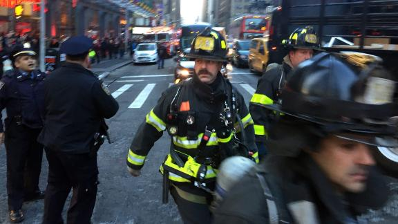 Firefighters arrived on Eighth Avenue near the scene of a reported explosion on Monday morning in Manhattan, New York, December 11, 2017. (David Scull/The New York Times)