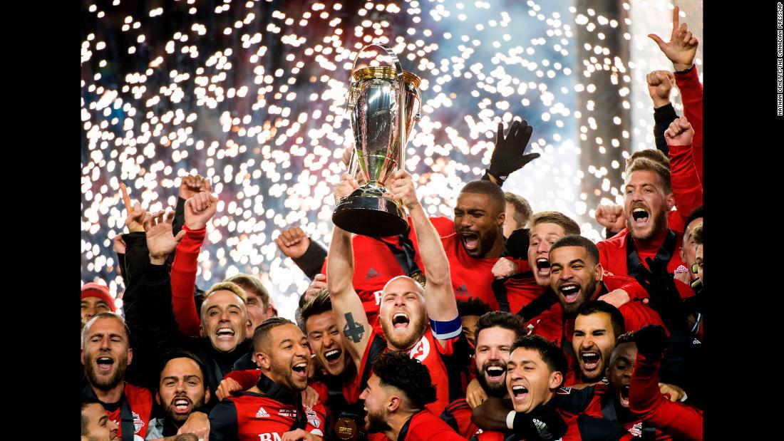 Toronto captain Michael Bradley hoists the MLS Cup after the soccer team won its first league title on Saturday, December 9. Toronto defeated Seattle 2-0 in what was a rematch of last year's final.