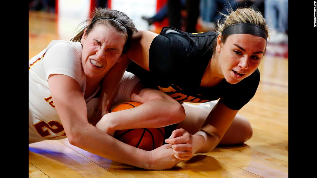 Iowa State's Bridget Carleton, left, scrambles for a loose ball with Iowa's Hannah Stewart during a college basketball game on Wednesday, December 6.