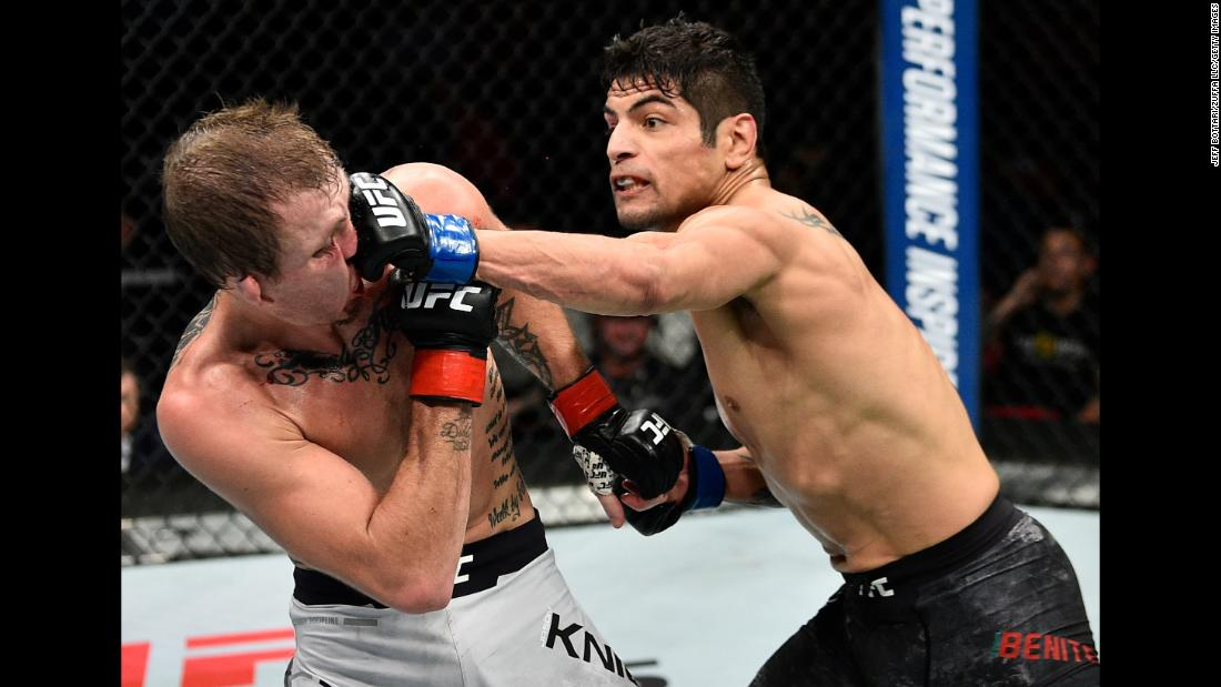Gabriel Benitez punches Jason Knight during their UFC featherweight bout on Saturday, December 9. Benitez won by unanimous decision.