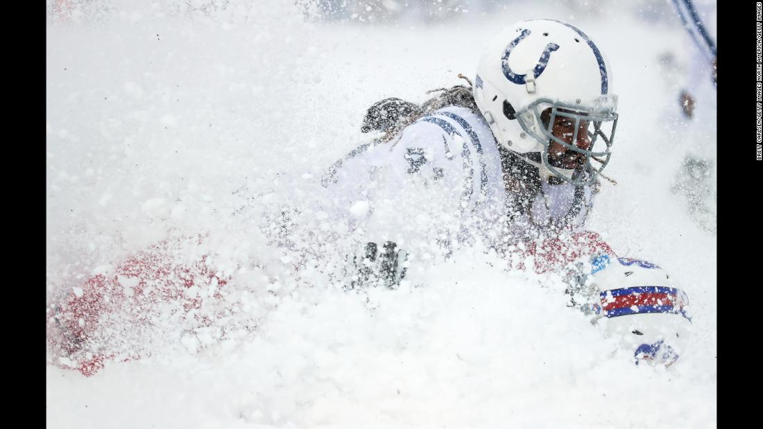 Indianapolis safety Matthias Farley tackles Buffalo tight end Charles Clay during a snowy NFL game in Orchard Park, New York, on Sunday, December 10.