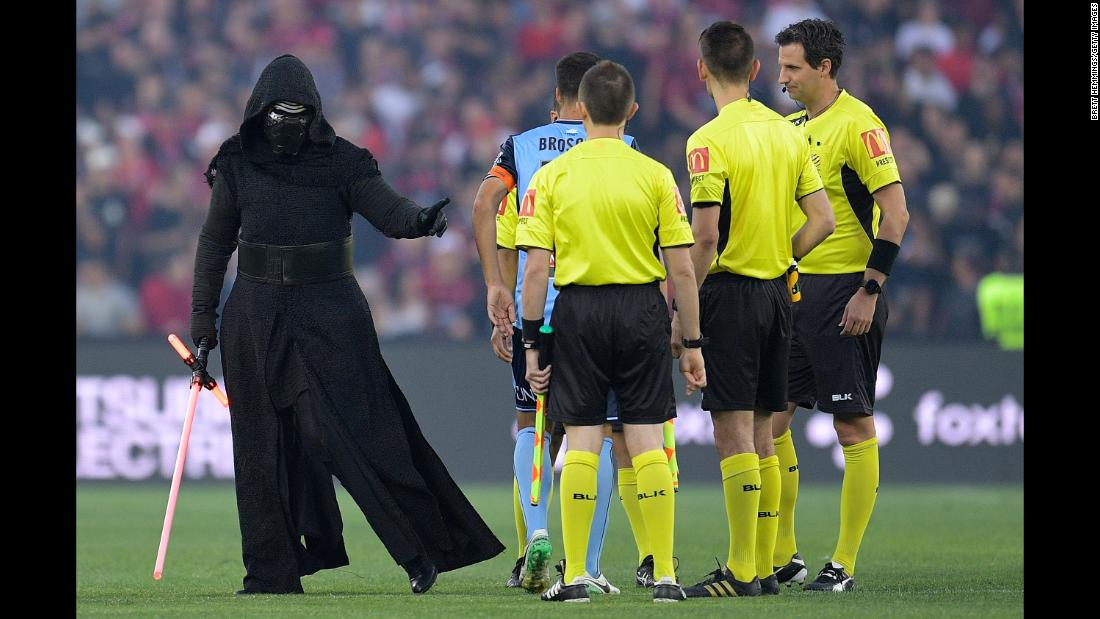 "A person dressed as ""Star Wars"" character Kylo Ren attends the coin toss before an Australian league soccer match in Sydney on Saturday, December 9."