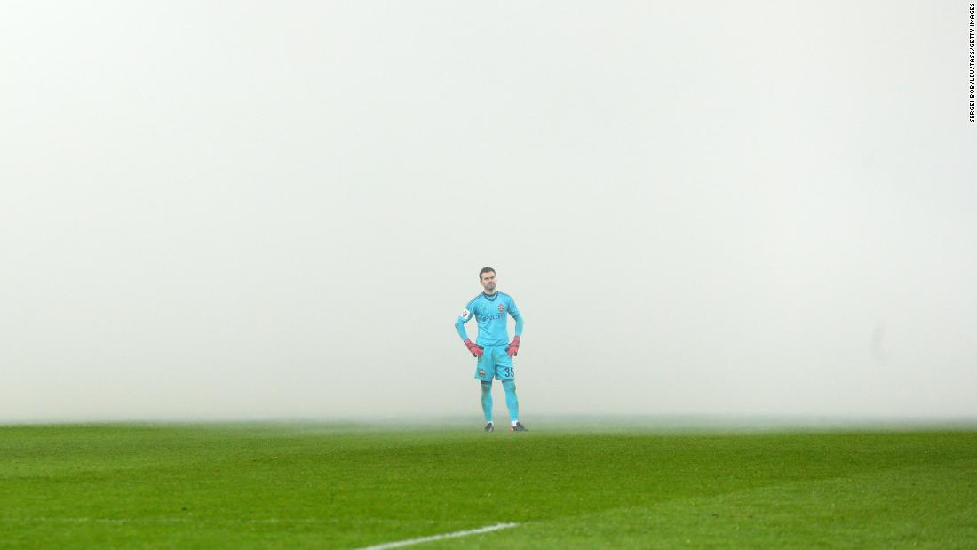 Smoke surrounds CSKA Moscow goalkeeper Igor Akinfeev during a Russian league match against Spartak Moscow on Sunday, December 10. The smoke came from flares that fans had lit.