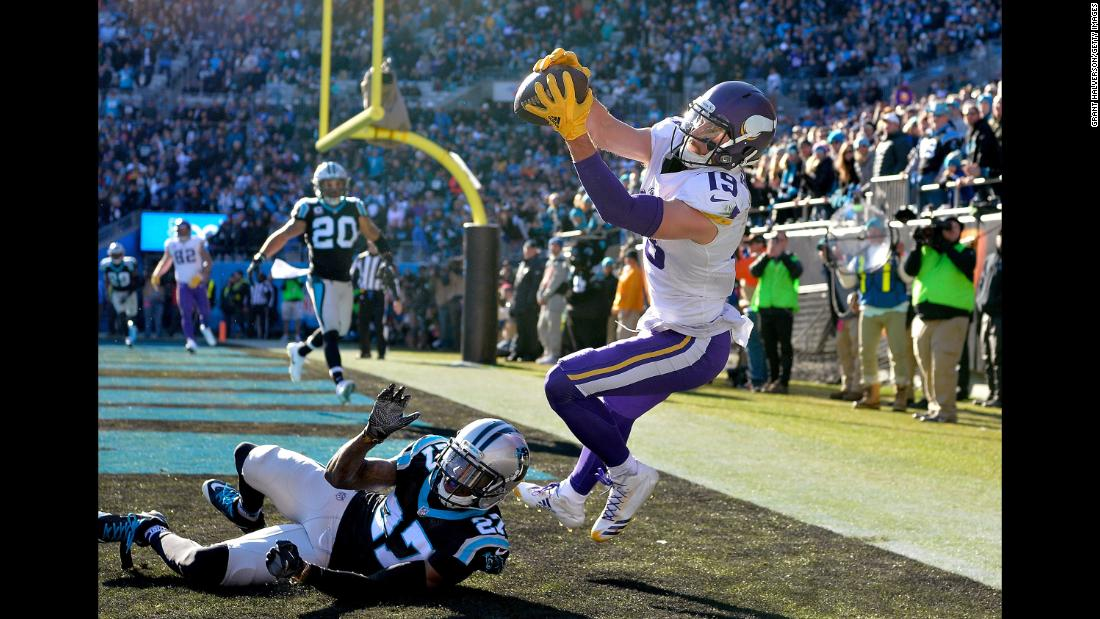 Minnesota wide receiver Adam Thielen tries to pull in a pass during an NFL game in Charlotte, North Carolina, on Sunday, December 10. It was initially ruled a touchdown catch, but it was overturned after a replay showed Thielen bobbling the ball as he went out of bounds.