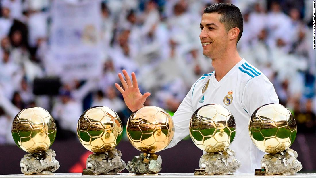 "Real Madrid star Cristiano Ronaldo poses with his <a href=""http://www.cnn.com/2017/12/08/football/cristiano-ronaldo-ballon-dor-lionel-messi-social-media/index.html"" target=""_blank"">five Ballon d'Or trophies</a> before a Spanish league match against Sevilla on Saturday, December 9. Ronaldo now shares the record with Barcelona's Lionel Messi."