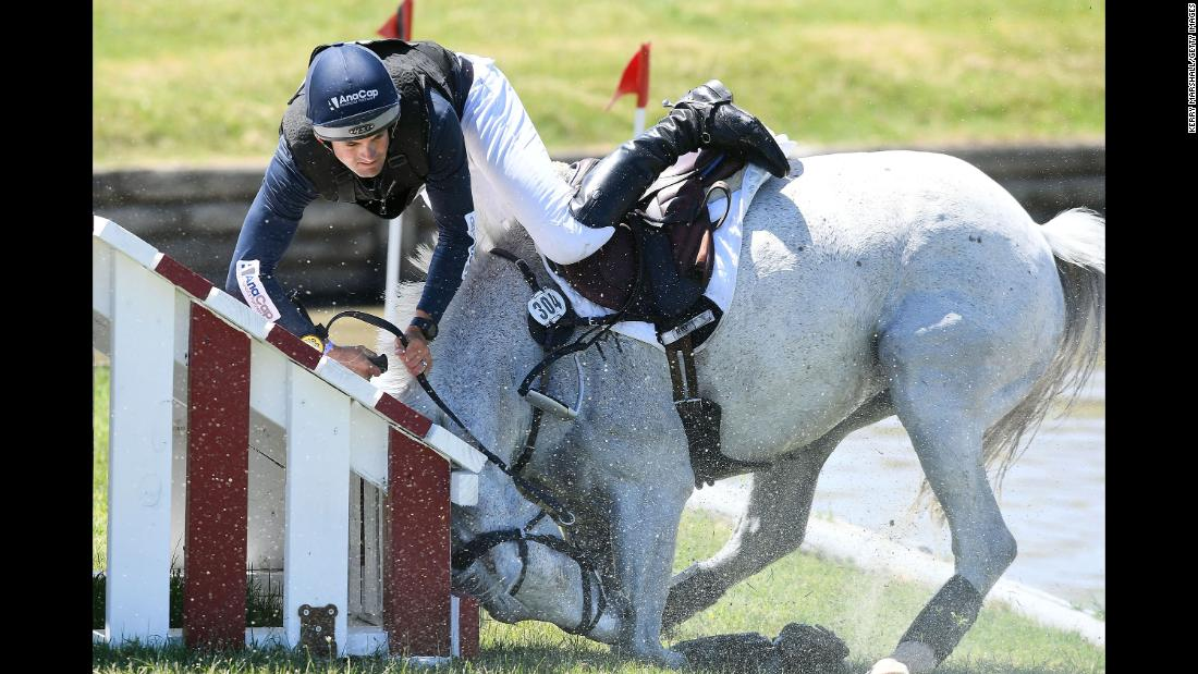 Jock Paget tumbles from Snow Leopard during the cross-country phase of the Puhinui International Horse Trials, a three-day event in Auckland, New Zealand, on Saturday, December 9.