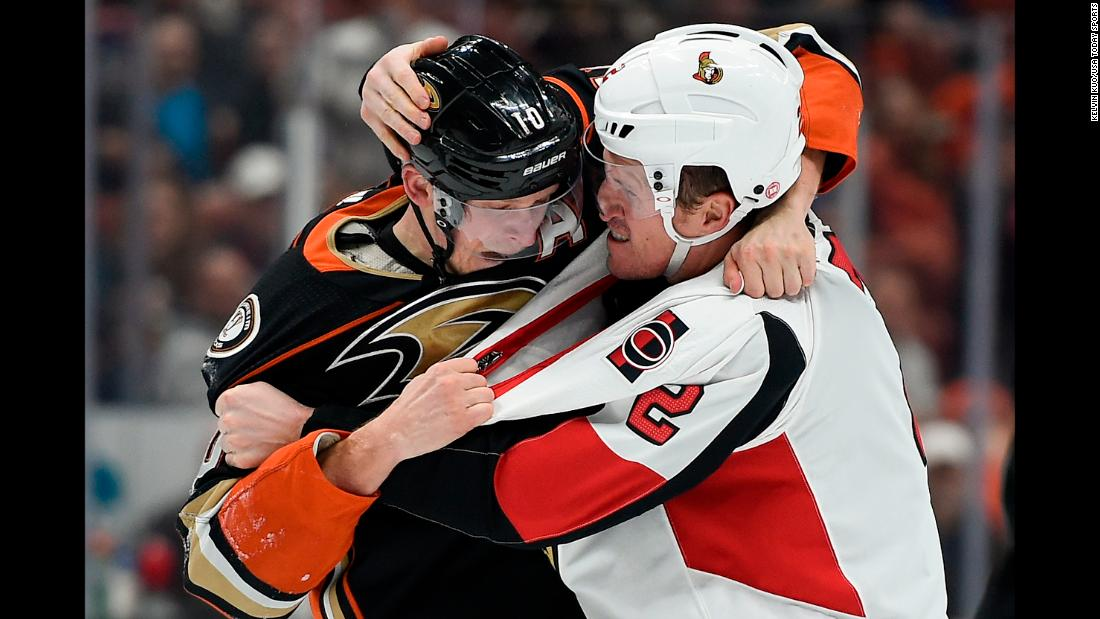 Anaheim forward Corey Perry, left, fights Ottawa defenseman Dion Phaneuf during an NHL game in Anaheim, California, on Wednesday, December 6.