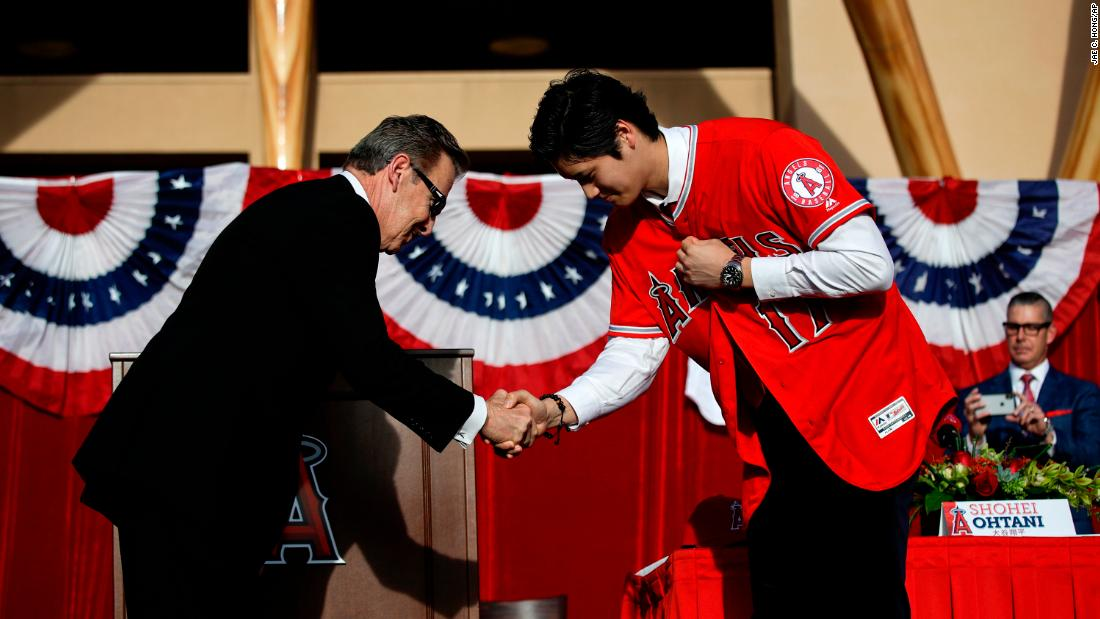 "Japanese baseball star Shohei Ohtani, right, shakes hands with Los Angeles Angels owner Arte Moreno during a news conference in Anaheim, California, on Saturday, December 9. Ohtani, a pitcher and outfielder, <a href=""http://bleacherreport.com/articles/2745772-shohei-ohtani-agrees-to-contract-with-angels-over-mariners-dodgers-and-others"" target=""_blank"">chose to sign with the Angels</a> over several other Major League teams."