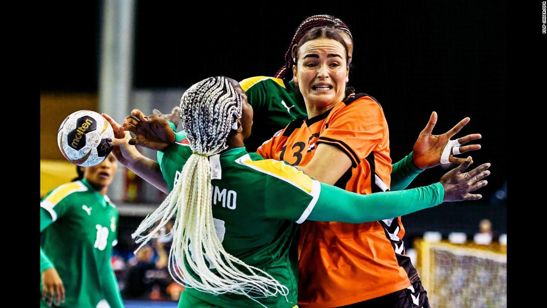 Cameroon's Jacky Baniomo, left, competes against the Netherlands' Yvette Broch during a match at the World Handball Championship on Tuesday, December 5.